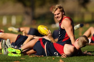 Jack Watts watches his teammate stretching. Because stretching is fascinating.